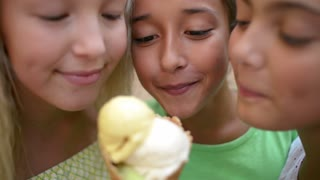 Three funny Girls eat fruity Plomber Ice cream Cone