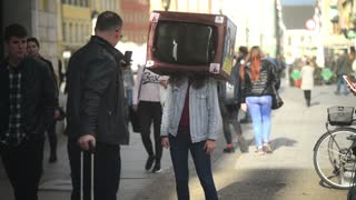 Tourist make Photo of young Girl with TV on a Head - City Centre of Wroclaw