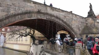 Tourists under the Charles Bridge in Prague
