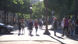 Traffic and Pedestrians People walking down the street on the Street Champs Elysees in Paris - Summer Day