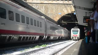 Train arrive at the Station in Genova Italy - summer day