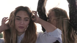 Two Young Girls Teenagers dancing together on a River Yacht - Long Hair on Wind