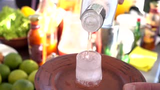 Vodka Poured Into A Ice Glass