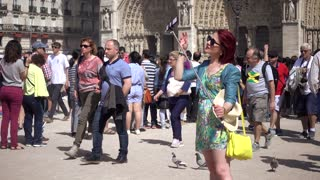 Woman take selfie photo via Mobile Phone near Notre Dame de Paris in summer day