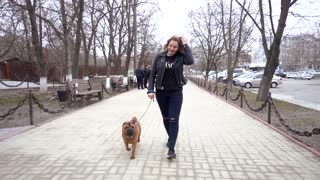 Woman Walking Her Dog Sharpei At The City Street