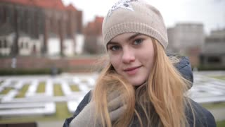 Young Blonde Girl travel Europe City Wroclaw, looking smiling to a Camera