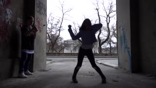 Young Boy and Girl dancing fun on the City Street Arch Gateway - dark Suburb