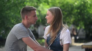 Young Boy and Girl Kiss and Hug gently touching Face on evening romantic Date