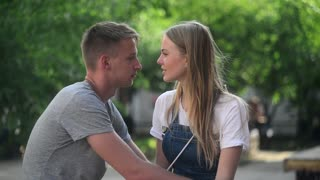 Young Boy and Girl laughing talk on evening romantic Date
