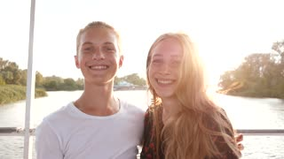 Young Girl and Boy Teenagers Smiling together having fun - Portrait