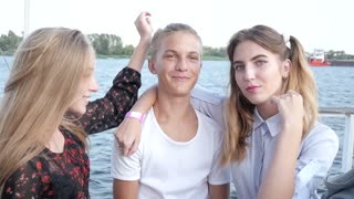 Young Girls and Boy Teenagers together on River  - Portrait posing to a Camera