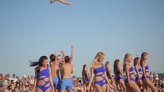 Young Girls Do Cheerleading performance on the Beach Party