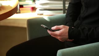 Young Guy with Mobile Smart Phone chatting Browse internet in the Office