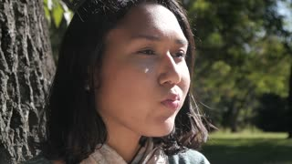 Young Latin Woman Portrait Blowing a Bubble Gum in a Park