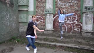 Young Modern Boy and Girl dancing fun on the City Street - suburb children