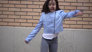 Young Modern Girl dancing fun on the City Street - suburb children