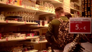 Young People looking for Souvenirs in Store on Friedrichstrasse Berlin