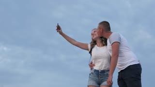 Young People Lovers on the romantic Date kissing Selfie Photo in Park - Night