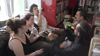 Young People Students having fun drinking alcohol Beer in a Campus Library