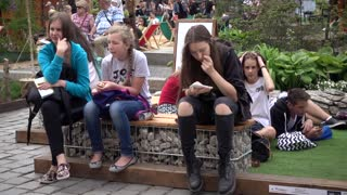 Young people teenagers relax, sitting in city park festival - Poland Wroclaw
