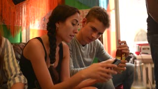 Young Woman use Mobile Smart Phone at the House Party