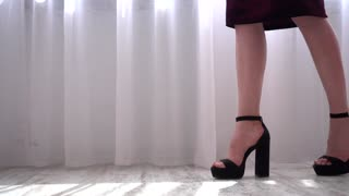 Young Woman Walk High Heels Shoes In A Bedroom