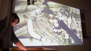 View Of Woman Finger Drawing Beautiful Picture By Sand. Art. Creative. Lighting