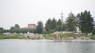 Wooden raft floating on the lake in the park Leolandia Italy