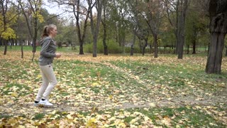 Young Beautiful Sportive Girl Training In Park