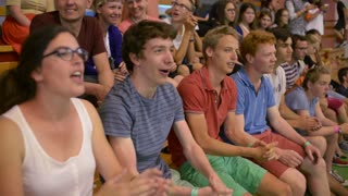 Young Catholics in the Stands rooting for their Church Team - School Gym