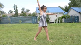 Young girl dancing fun in the summer park dressed T-shirt