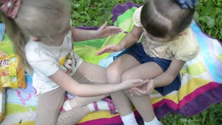 Young Girls Playing clap hands, Friends in the park picnic