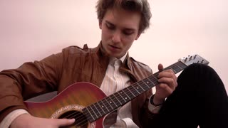 Young Man Fashion Model posing with guitar