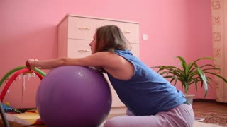 young pregnant woman doing exercises from yoga sitting on the floor
