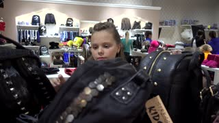 Young Teenager Girl Brunette Get Shopping At The Mall - School Bags on the shelf