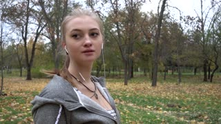 Young Woman Breathing Hurdly Jogging In The Autumn Park, Slow Motion Hd