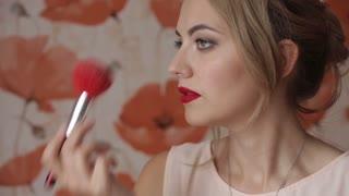 beautiful woman gets makeup