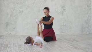 a little ballerina and her teacher. occupation in a choreographic studio