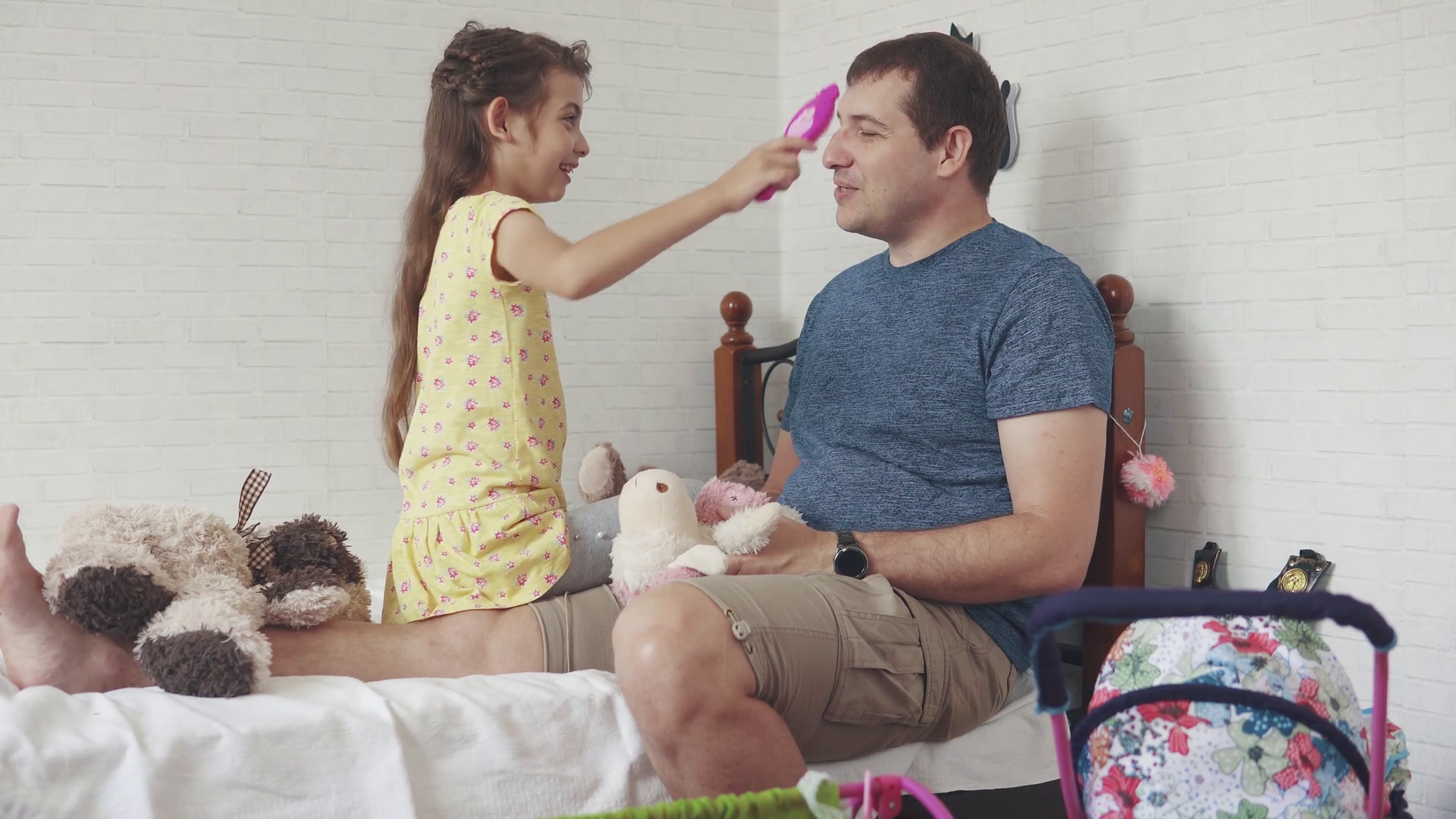 a little girl combs her dad with a toy comb. father spends time with his daughter Stock Video Footage - Storyblocks