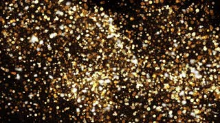 Abstract background with shining bokeh sparkles. Gold particles glitter.