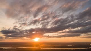 Aerial Hyperlapse of sky with Incredible Orange and Red Sunset