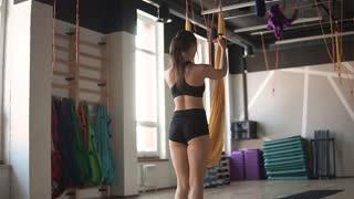 antigravity yoga. girl in sportswear do splits