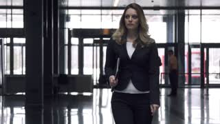 Attractive business woman walking on office building