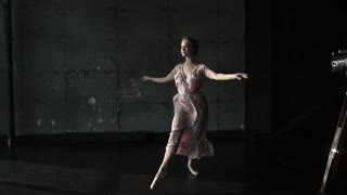 ballet dancer doing a high jump. Young graceful ballerina doing twine in the air. slow motion