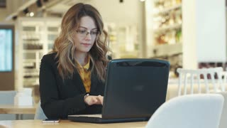 business woman working behind laptop