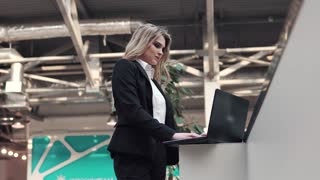 business woman working on laptop standing