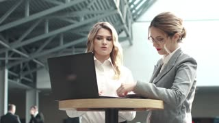 Caucasian women at a business meeting. girl in business clothes working with laptop