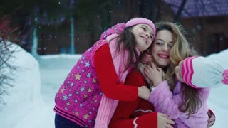 children hugging mother. the child is happy. mom and daughter. Slow Motion