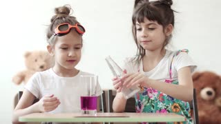 children's science. children conduct a chemical experiment at home. mixing of iodine and hydrogen peroxide
