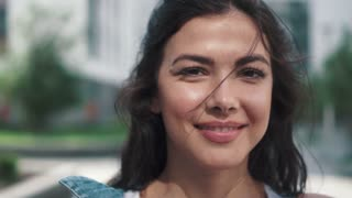 Close-up portrait of a beautiful young girl. Beautiful caucasian brunette woman laughing. slow motion